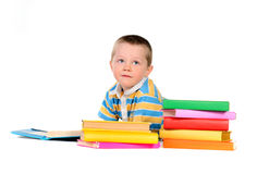Boy with piles of colored books Stock Photo