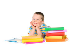 Boy with piles of colored books Royalty Free Stock Images