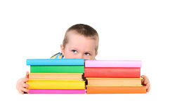 Boy with piles of colored books Stock Image