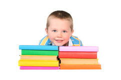 Boy with piles of colored books Royalty Free Stock Photo