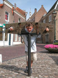 Boy in pillory. Little boy with spiky hair for fun in a pillory Stock Photography