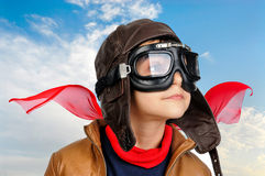 Boy pilot. Young boy pilot against a blue cloudy sky Stock Images
