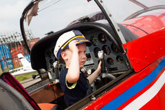 Boy pilot a real airplane steering wheel, instruments, Royalty Free Stock Photos