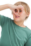 Boy pinching his nose Stock Images