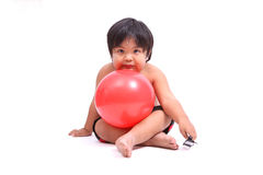 Boy with pink fitness ball on white background Stock Image