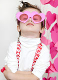 Boy in pink glasses. On st.Valentine day royalty free stock images