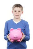 Boy with pink piggy bank Stock Images