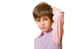 The boy in a pink shirt. Rubs a nape stock photography