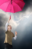 Boy with pink umbrella Royalty Free Stock Photos