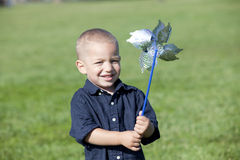 Boy pinwheel Stock Images