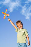 Boy with pinwheel Stock Photography