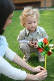 Boy with a pinwheel Stock Photography