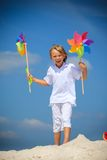 Boy with pinwheels Stock Images