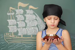 Boy pirate with compass Stock Images