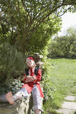 Boy In Pirate Costume With Arms Crossed In Garden Royalty Free Stock Images