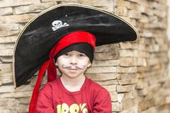 Boy in a pirate costume on the celebration of the new year 2018 royalty free stock photography