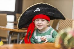 Boy in a pirate costume on the celebration of the new year 2018. Boy in a pirate costume on the celebration of the new year Stock Photo
