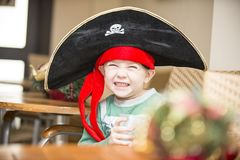 Boy in a pirate costume on the celebration of the new year 2018. Boy in a pirate costume on the celebration of the new year Stock Images