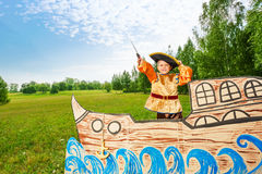 Boy in pirate costume stand on ship with sword Royalty Free Stock Photography