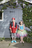 Boy In Pirate And Girl In Fairy Costumes By Shed Stock Photography