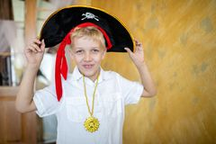 Boy pirate preparing for the holiday Halloween royalty free stock image