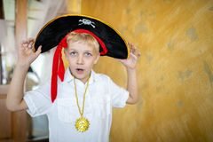 Boy pirate preparing for the holiday Halloween stock photography