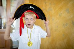 Boy pirate preparing for the holiday Halloween stock image