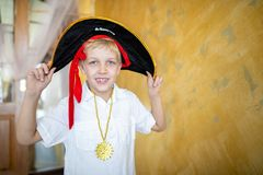 Boy pirate preparing for the holiday Halloween royalty free stock photography