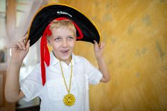Boy pirate preparing for the holiday Halloween royalty free stock photo