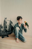 Boy Pirate With A Parrot And A Sailboat Stock Image