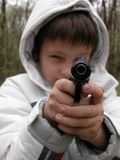 Boy with pistol. Boy with big black pistol in hand Royalty Free Stock Images