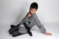 Boy with pistols Royalty Free Stock Photo
