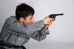 Boy with pistols. Boy with toy pistols playing cowboy stock photos