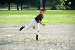 Boy pitching in youth baseball game stock photo