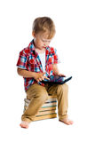 Boy in a plaid shirt with a tablet computer Stock Image