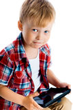 Boy in a plaid shirt with a tablet computer Stock Photography