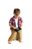 Boy in a plaid shirt with a tablet computer Stock Images