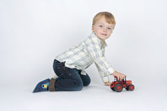 Boy plaies with car. Royalty Free Stock Photography