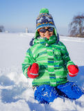 Boy plaing in the snow Stock Photos