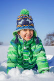 Boy plaing in the snow. Little boy having fun in the snow Royalty Free Stock Images