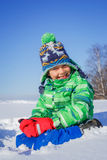 Boy plaing in the snow. Little boy having fun in the snow Royalty Free Stock Photography