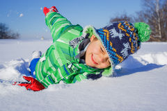 Boy plaing in the snow. Little boy having fun in the snow Royalty Free Stock Photos