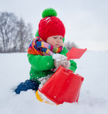 Boy plaing in the snow. Little boy having fun in the snow Stock Photo