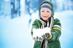 Boy is plaing with snow Stock Image