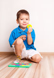 Boy plaing with toy Stock Images