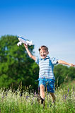 Boy with plane Royalty Free Stock Photo