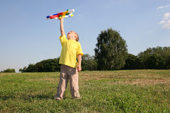 Boy with plane. On meadow Royalty Free Stock Image