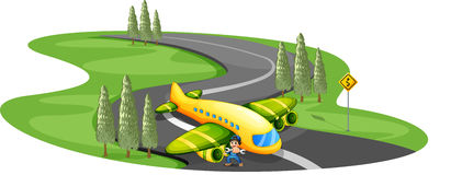 A boy with a plane landing at the long winding road Royalty Free Stock Photo