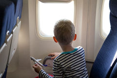 Boy in the plane. Little boy in the plane looking out the window Royalty Free Stock Images