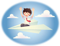 A boy in a plane. A boy riding a paper plane. This can represent dreams, fun and play Royalty Free Stock Photos